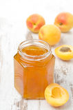 Apricot confiture in a glass jar and fresh apricots Royalty Free Stock Image
