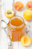Apricot confiture in a glass jar, top view Royalty Free Stock Photo