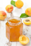 Apricot confiture in a glass jar Royalty Free Stock Photo