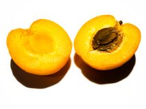 Apricot cut in half. stock images