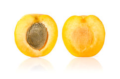 Apricot Cut in Half. On White Background Stock Images