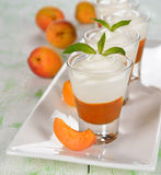 Apricot dessert in small glasses Stock Photography