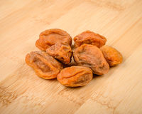 Apricot. Dried apricots on a wooden cutting board Stock Images