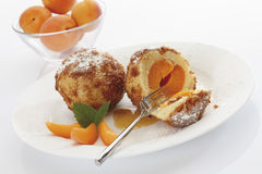 Apricot dumpling breaded, served on plate,in the background bowl filled with apricots Royalty Free Stock Image