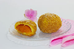 Apricot dumpling with flower. A whole and a half dumplings with a pink flower Stock Photos