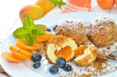 Apricot dumplings. Sweet apricot dumplings with some blueberries, an Austrian cooked dessert Royalty Free Stock Photography
