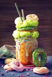 Apricot freakshake with donut. And candy floss stock image