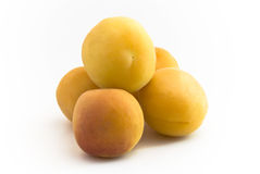 Apricot fruit heap. Apricot fruits building a heap on white background stock photography
