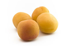 Apricot Fruits. Four apricot Fruits lying together on white background royalty free stock photos
