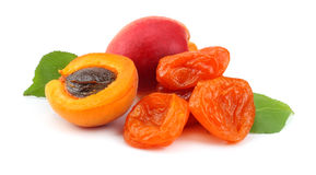 Apricot fruits with green leaf and dried apricot isolated on white background Royalty Free Stock Photos