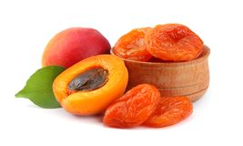 Apricot fruits with green leaf and dried apricot isolated on white background Clipping Path Stock Images