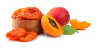 Apricot fruits with green leaf and dried apricot isolated on white background Clipping Path Royalty Free Stock Photos