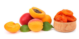 Apricot fruits with green leaf and dried apricot isolated on white background Clipping Path Royalty Free Stock Images