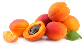 Apricot fruits with green leaf isolated on white background Clipping Path Royalty Free Stock Image