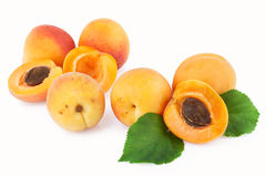 Apricot fruits scattered isolated on white Royalty Free Stock Photo
