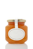 Apricot glass jar Royalty Free Stock Photography