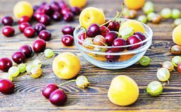 Apricot gooseberry and cherry wood table Stock Image