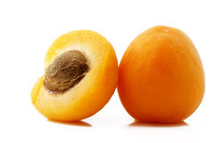 Apricot and a half. One apricot and a half on white background royalty free stock photos