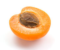 Apricot. Half  on white Royalty Free Stock Photography