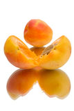 Apricot with halves. On white background royalty free stock image