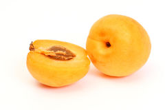 Apricot with halves. On white background Royalty Free Stock Photos