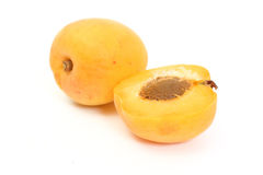Apricot with halves. On white background stock photos