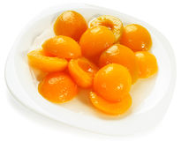 Apricot halves on plate Stock Images
