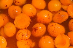 Apricot halves in syrup, dried apricots cooking. Dried apricots. Technology of preparation of candied apricots stock photos