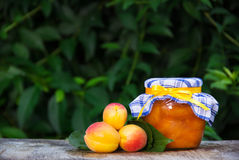 Apricot homemade jam on the table. Useful summer desserts. Copy space. Apricot homemade jam on the table. Useful summer desserts Stock Photos