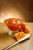 Apricot jam. With toast and knife Royalty Free Stock Photography