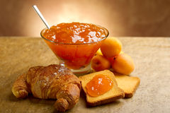 Apricot jam. With toast and croissant Stock Photos