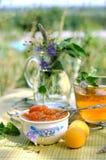 Apricot jam. Summer tea time: apricot jam and mint tea Stock Photo