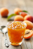 Apricot jam. Glass with homemade apricot jam Royalty Free Stock Photography
