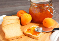 Apricot jam. On the table Royalty Free Stock Photography