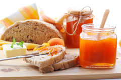 Apricot jam. In jar,  fresh fruits with bread and butter Royalty Free Stock Photo