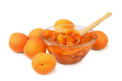 Apricot jam. And some fresh apricots isolated on white Royalty Free Stock Images