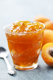 Apricot jam. Glass with homemade apricot jam Royalty Free Stock Photos