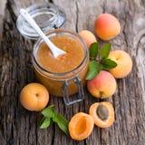 Apricot jam. Fresh apricot jam on wooden ground Royalty Free Stock Photos