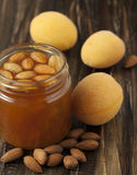 Apricot jam with almonds. Stock Images