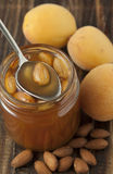 Apricot jam with almonds. Stock Photo