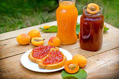 Apricot jam and apricot juice. Delicious breakfast - apricot jam on bread Royalty Free Stock Images