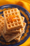 Apricot jam on Belgian waffle Royalty Free Stock Photo