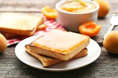Apricot jam with bread toasts Royalty Free Stock Photo