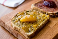 Apricot jam on bread with Damson Plum Jam Royalty Free Stock Photography