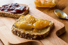 Apricot jam on bread with Damson Plum Jam Royalty Free Stock Photo