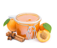 Apricot jam with cinnamon and fresh fruits isolated on white Stock Photo