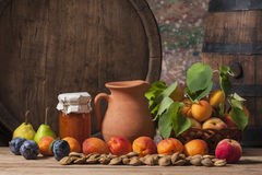 Apricot jam, fresh fruit and a wooden barrel Royalty Free Stock Images