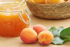 Apricot jam and fresh fruit on wooden table. Close up view. Stock Images