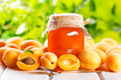 Apricot jam with fresh fruits. On wooden table Royalty Free Stock Images