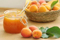 Apricot jam and fresh fruits on wooden table. Close up view. Royalty Free Stock Photo
